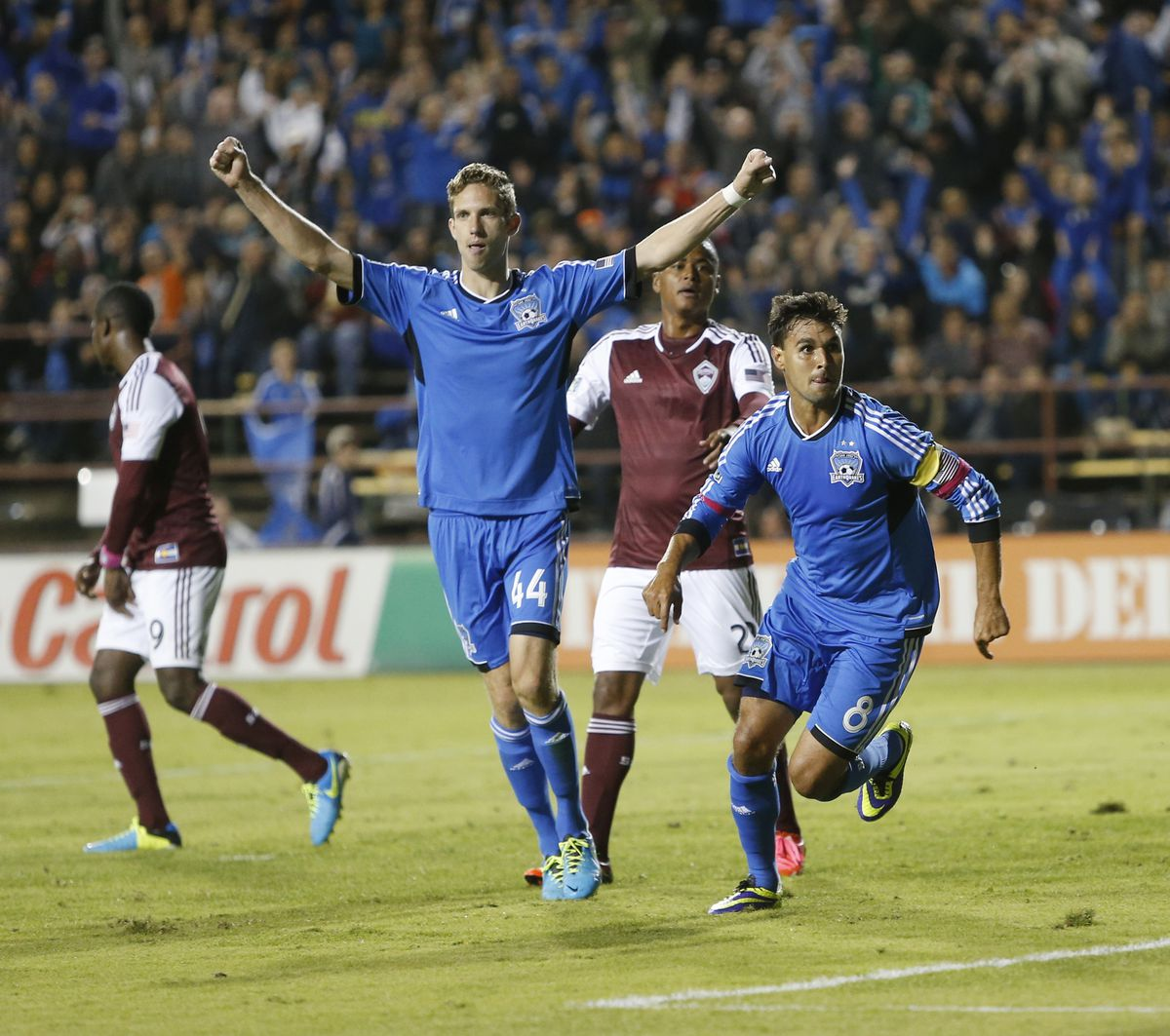 San Jose Earthquakes Clarence Goodson (44) celebrates as Chris Wondolowski (8) runs to sidelines after scoring 1-0 goal against the Colorado Rapids in the second half at Buck Shaw Stadium in Santa Clara, Calif., on Wednesday, Oct. 9, 2013. (Josie Lepe