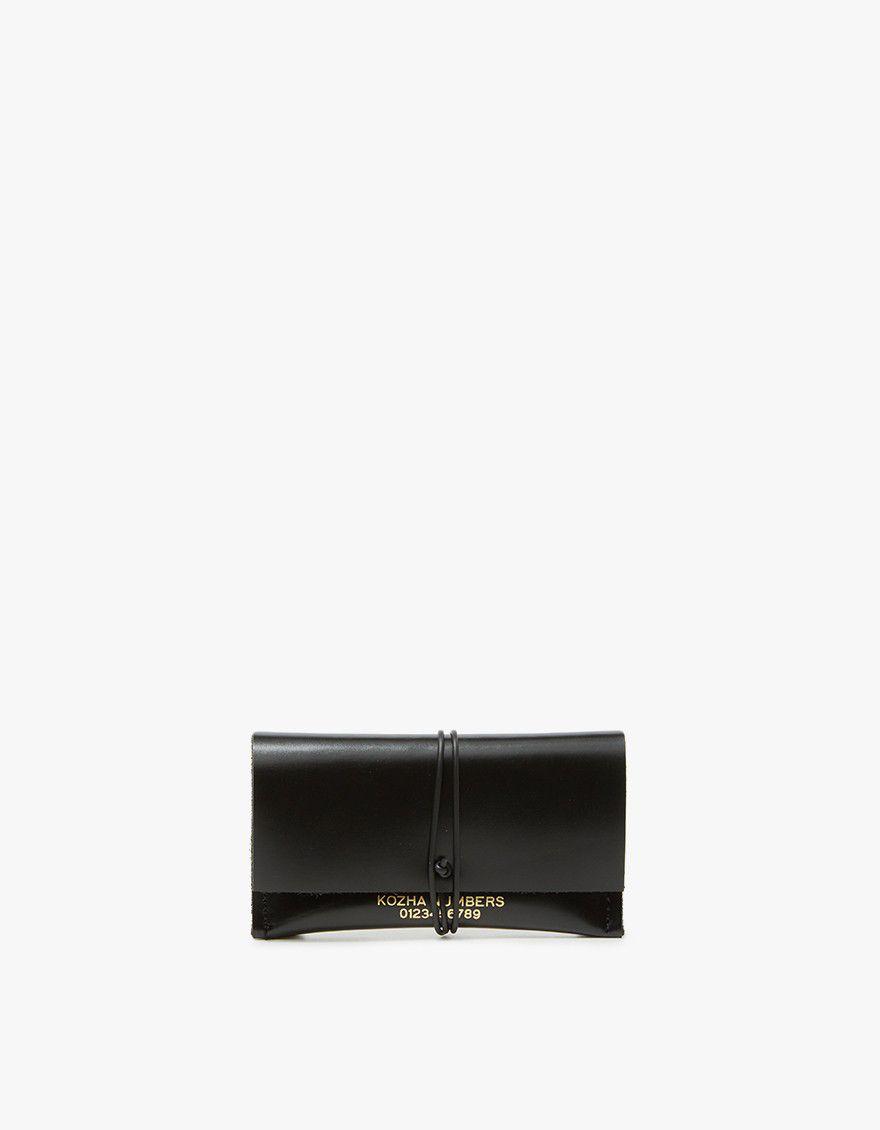 Black single slot leather card holder.