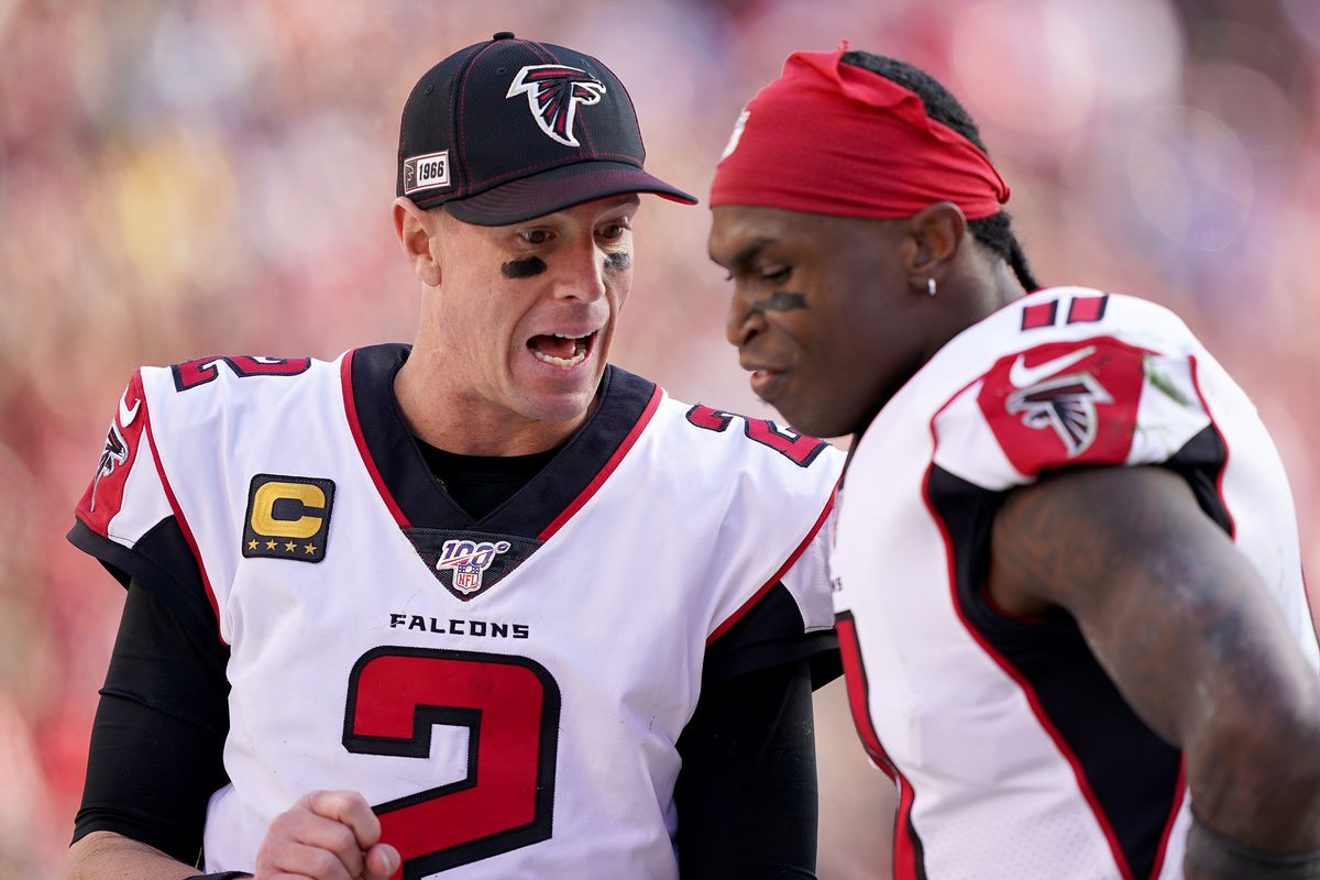 Quarterback Matt Ryan and wide receiver Julio Jones of the Atlanta Falcons talk on the sidlines during the game against the San Francisco 49ers at Levi's Stadium on December 15, 2019 in Santa Clara, California.