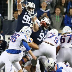 Brigham Young Cougars defensive lineman Kesni Tausinga (94) and Brigham Young Cougars defensive lineman Corbin Kaufusi (90) try to block a field goal by Boise State kicker Hagen Hoggarth in Provo on Friday, Oct. 6, 2017.