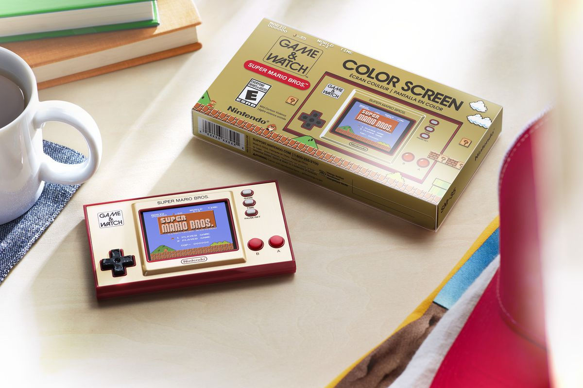 A photo of the Game & Watch: Super Mario Bros. handheld on a table