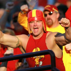 An Iowa State Cyclones fan cheers on his team in the 1st quarter of a game against the Minnesota Golden Gophers in the 2009 Insight Bowl at Sun Devil Stadium.