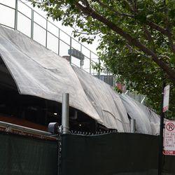 2:47 p.m. Wind blowing the tarps along Waveland -