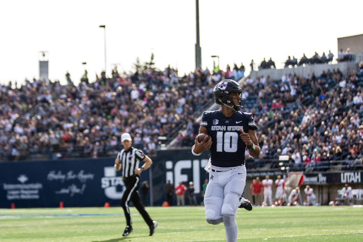 Utah State sophomore quarterback Jordan Love runs with the ball. Love accounted for five touchdowns — four passing and one rushing — to go along with a career-high 448 yards passing in the Aggies' 61-19 rout over New Mexico last weekend.