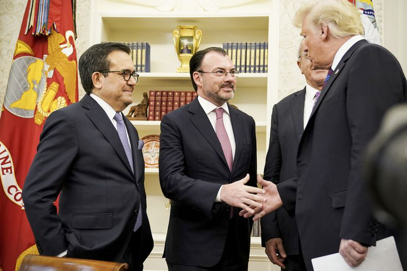 President Trump shake hands with Mexico's Foreign Minister Luis Videgaray Caso as he arrives to speak on trade in the Oval Office on August 27, 2018.