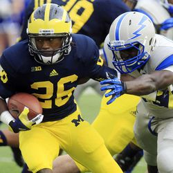 Michigan's Dennis Norfleet (26) pulls away from Air Force's Wes Cobb during a kickoff return in the second half of an NCAA college football game at Michigan Stadium in Ann Arbor, Mich., Saturday, Sept. 8, 2012. Michigan won 31-25.