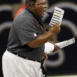 Kansas City Chiefs head coach Romeo Crennel calls out from the sideline in the first half of an NFL football game against the New Orleans Saints in New Orleans, Sunday, Sept. 23, 2012.