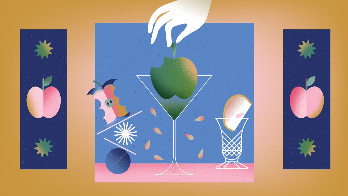 A hand lowers an apple into a martini glass. It's surrounded by an apple core balancing on the left and a wedge of cut apple in a glass on the right.