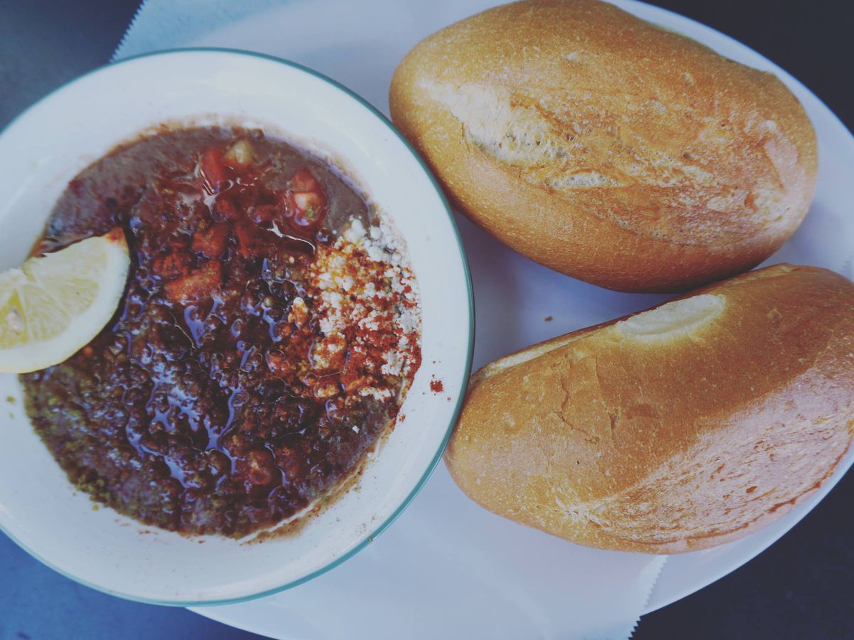 Shahan ful at Alem's, served with two crusty loaves of bread