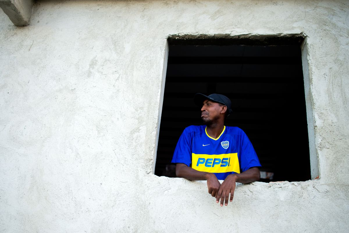 A Boca Juniors fan--watching another young talent leave, perhaps?