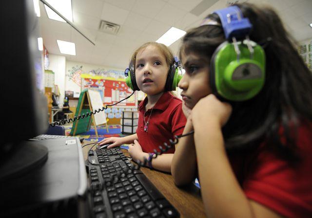 Kindergarteners use computers at IPS School 90.