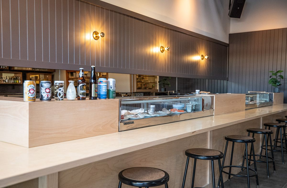 The redone bar of a new sushi restaurant with muted blonde tones.