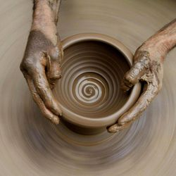 A Kashmiri potter makes earthen pots at his home on the outskirts of Srinagar, India, Sunday, April 22, 2012. April 22 is observed as Earth Day every year as a tool to raise ecological awareness.