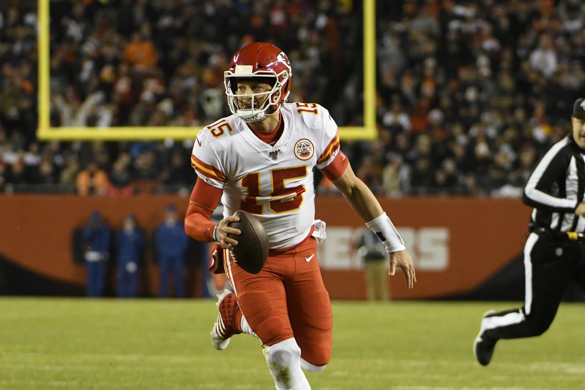 Kansas City Chiefs quarterback Patrick Mahomes runs for a touchdown against the Chicago Bears during the first half at Soldier Field.