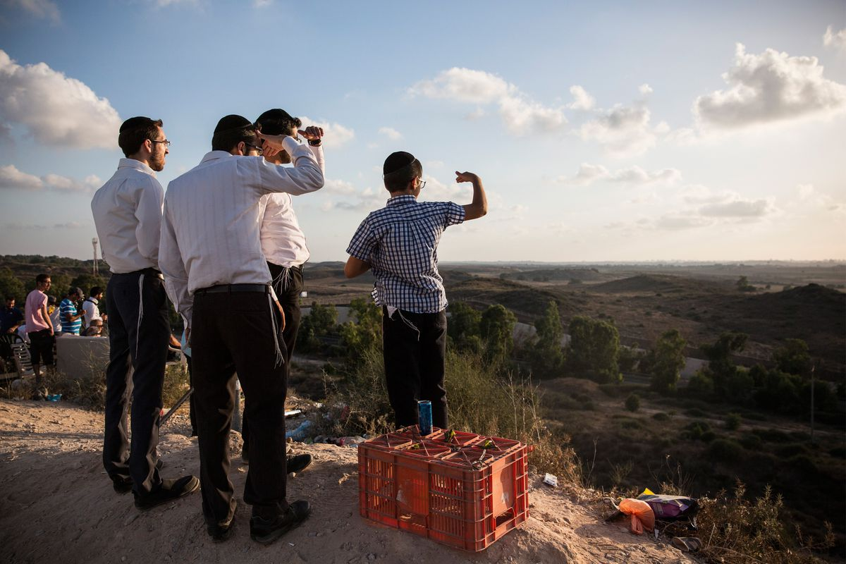 Israelis look for rocket fire from Gaza.