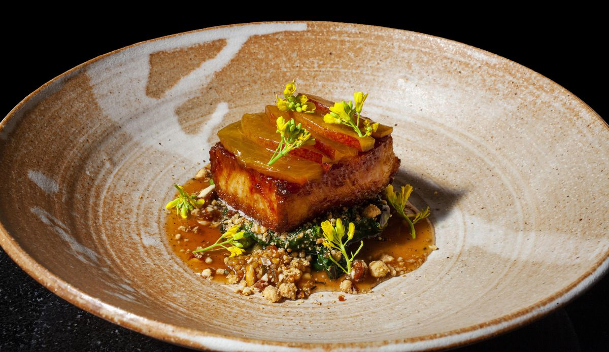 Indian, Thai and Vietnamese cuisines pepper the menu at Entente, which received one Michelin star on Thursday. Pictured is the Berkshire Pork Belly.