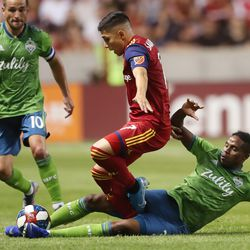 Real Salt Lake forward Jefferson Savarino (7) gets taken out by Seattle Sounders defender Joevin Jones (33) as RSL and the Sounders play at Rio Tinto Stadium in Sandy, Utah, on Wednesday, Aug. 14, 2019.