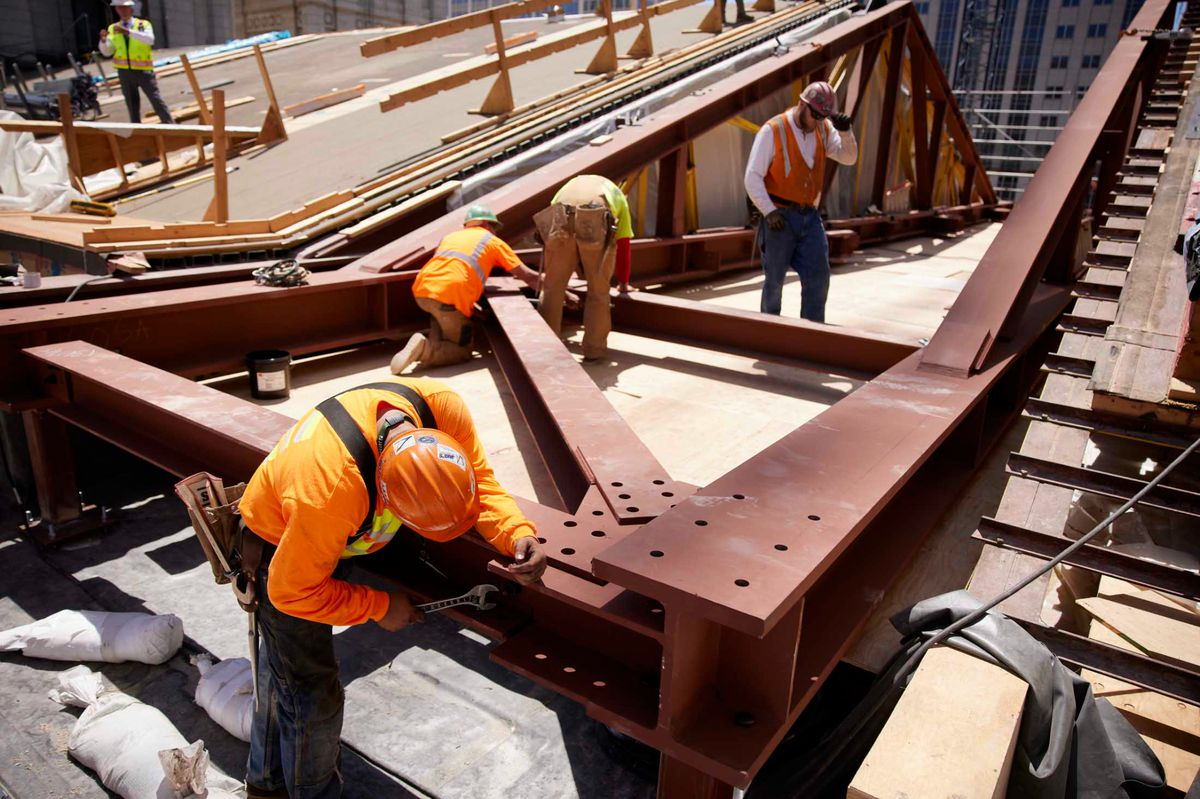 Workers prepare steel trusses for placement on the Salt Lake Temple roof as part of the renovation.