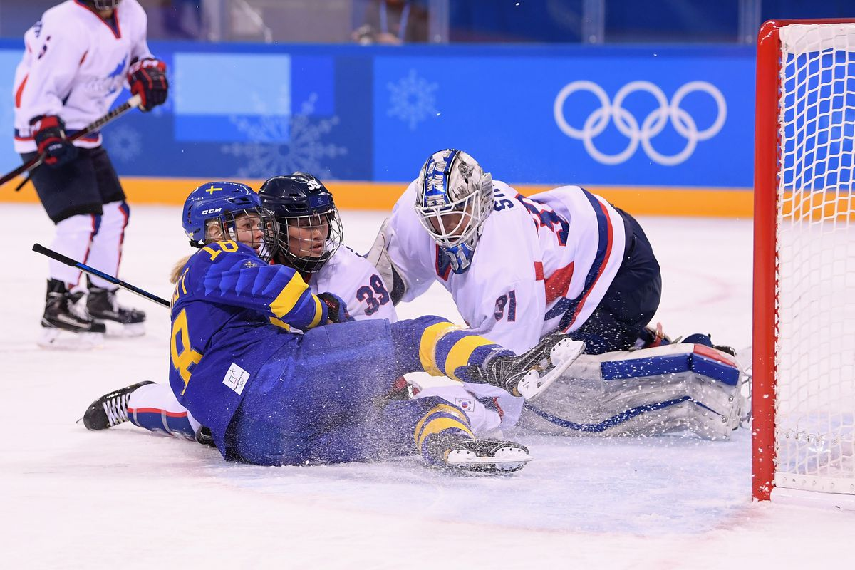 Anna Borgqvist #18 of Sweden gets tangled with Chung Gum Hwang #39 and So Jung Shin #31 of Korea