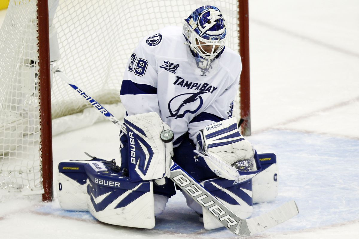 Mar 20, 2013; Toronto, Ontario, CAN; Tampa Bay Lightning goaltender Anders Lindback (39) makes a blocker save against the Toronto Maple Leafs at the Air Canada Centre. Toronto defeated Tampa Bay 4-2.