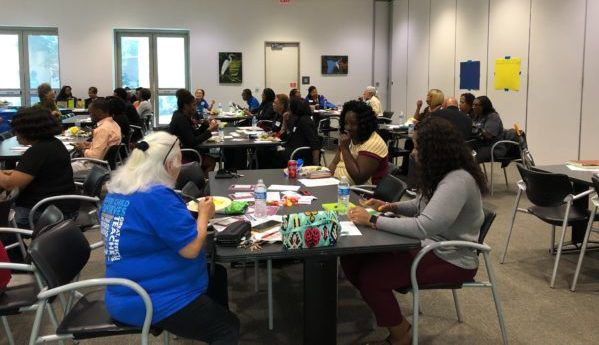 """Attendees were divided into small groups to answer questions like """"What issues do you think most impact a young child's ability to learn?"""""""