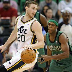 Utah Jazz shooting guard Gordon Hayward (20) makes a cut as Boston Celtics point guard Rajon Rondo (9) defends during a game at EnergySolutions Arena on Monday, Feb. 24, 2014.