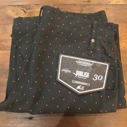 """Get in the holiday spirit with red polka dot pants ($88) by Publish available at <a href=""""http://psandqs.com/"""">Ps & Qs</a> in the South Street Headhouse District."""