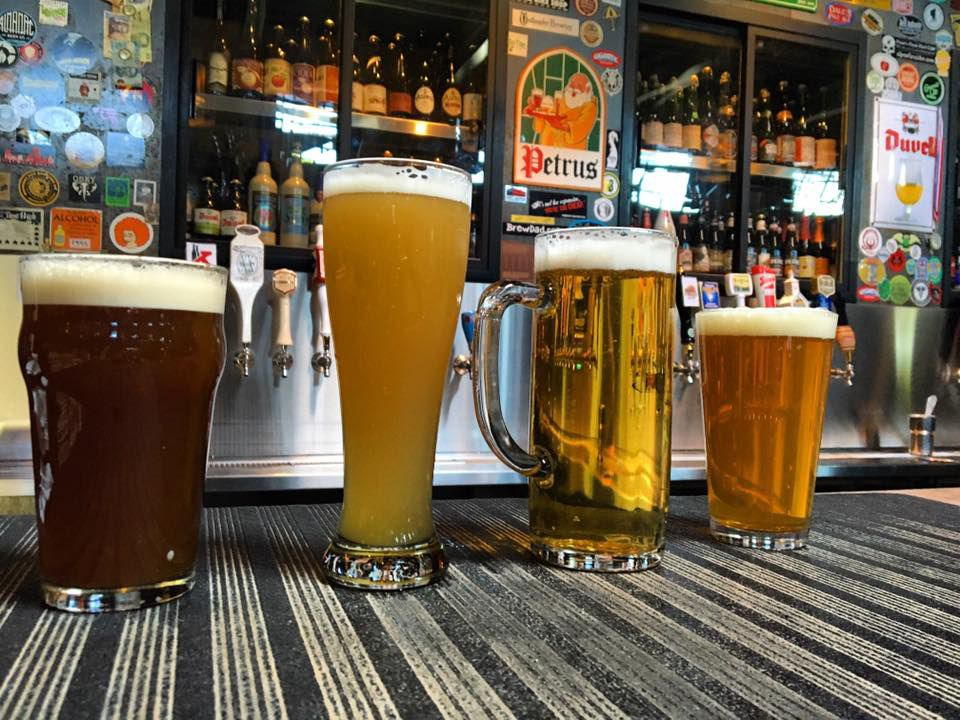 A selection of pints of beer, with varying color shades, at Brouwer's Cafe.