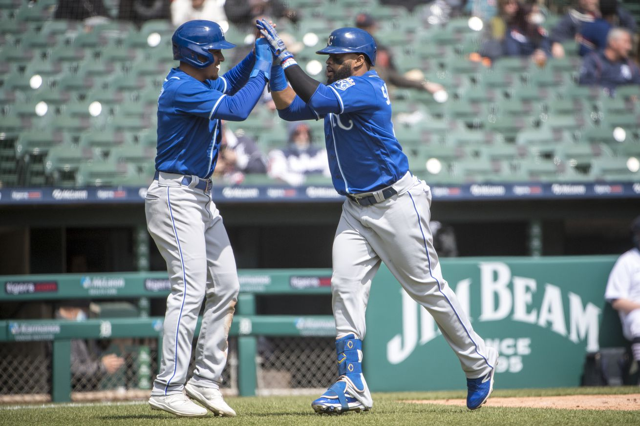 Nicky Lopez #8 and Carlos Santana #41 of the Kansas City Royals celebrate after Santana hit a home run against the Detroit Tigers during the top of the third inning at Comerica Park on April 26, 2021 in Detroit, Michigan.