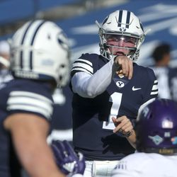 Brigham Young Cougars quarterback Zach Wilson flips a pass over the North Alabama defense during a game in Provo on Saturday, Nov. 21, 2020.