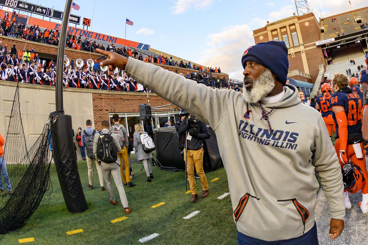 Illinois Fighting Illini head coach Lovie Smith celebrates after defeating the Rutgers Scarlet Knights at Memorial Stadium.