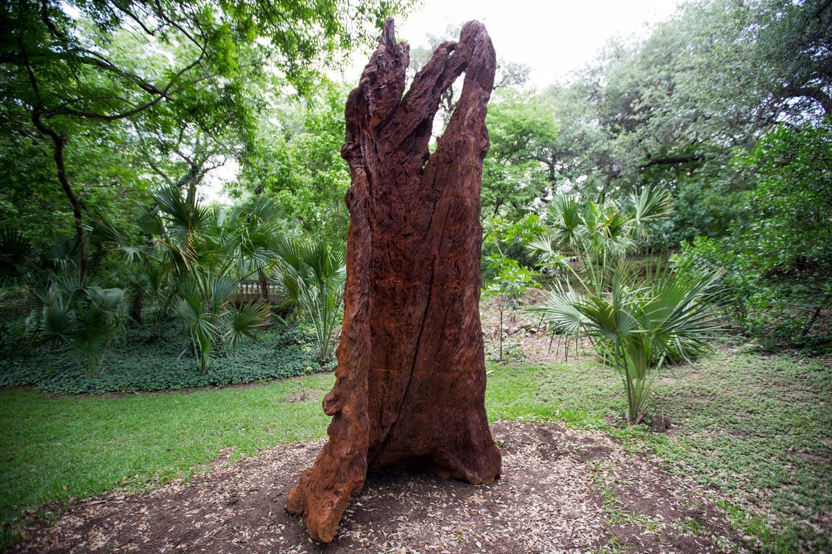 An iron sculpture that looks like remnants of a tree trunk