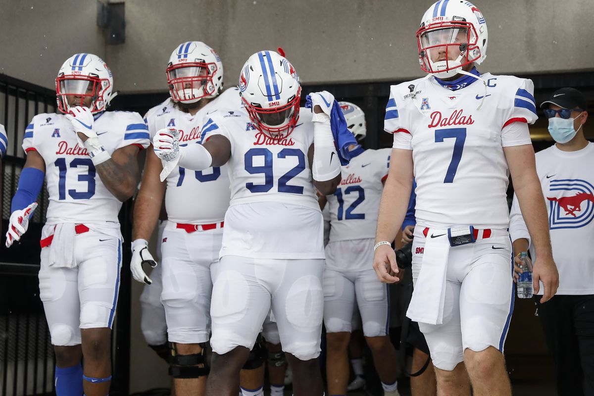 Shane Buechele of the Southern Methodist Mustangs walks out of the tunnel with teammates before the game against the Texas State Bobcats at Bobcat Stadium on September 05, 2020 in San Marcos, Texas.