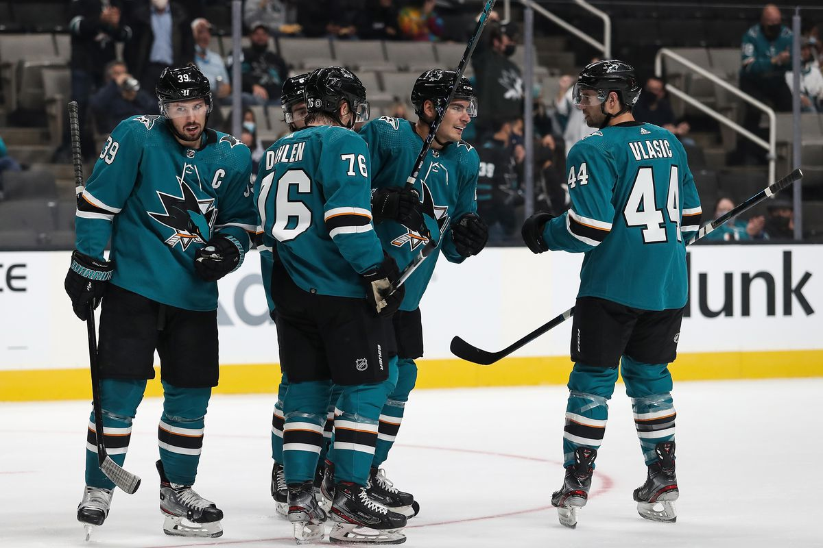 Timo Meier #28, Logan Couture #39 and Jonathan Dahlen #76 of the San Jose Sharks celebrate scoring a goal against the Los Angeles Kings at SAP Center on September 28, 2021 in San Jose, California.
