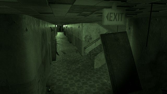 Phasmophobia - a night vision view of a high school hallway.