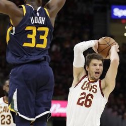 Cleveland Cavaliers' Kyle Korver (26) looks to pass against Utah Jazz's Ekpe Udoh (33) in the second half of an NBA basketball game, Saturday, Dec. 16, 2017, in Cleveland. (AP Photo/Tony Dejak)