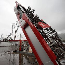 A gas station is damaged in Tacloban, Friday, Nov. 22, 2013.