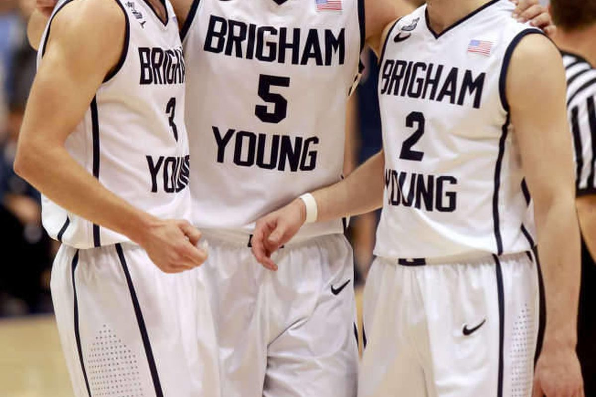 BYU's Tyler Haws, Kyle Collinsworth and Matt Carlino talk during a basketball game against Saint Mary's at the Marriott Center in Provo on Saturday, Feb. 1, 2014. BYU won 84-71.