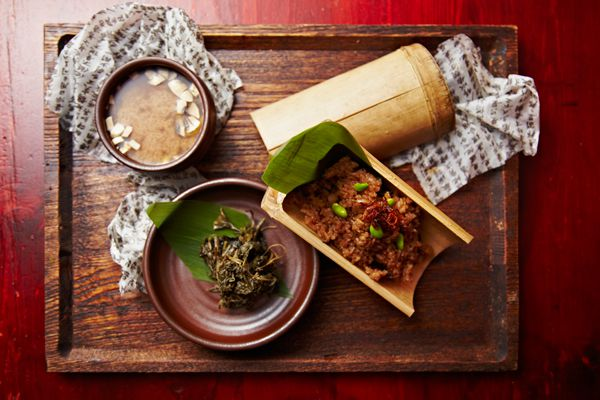 A wooden tray with plates from Hangawi's temple-inspired tasting menus.