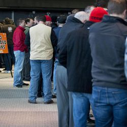 Gun enthusiasts line up before the doors open at the South Towne Expo Center for the 2013 Rocky Mountain Gun Show, Saturday, Jan. 5, 2013.