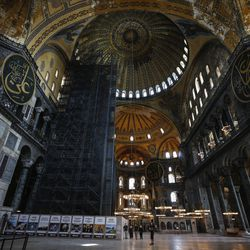 People visit the Byzantine-era Hagia Sophia, one of Istanbul's main tourist attractions in the historic Sultanahmet district of Istanbul, Thursday, June 25, 2020. Turkey's highest administrative court on Thursday July 2, 2020, began considering a request for the UNESCO World Heritage site that now serves as a museum be reverted back into a mosque.