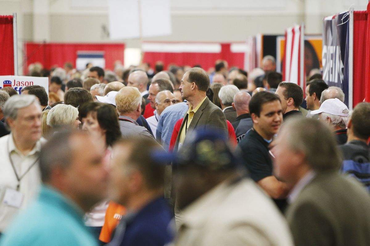 Attendees walk through the Republican State Convention at South Towne Expo Center in Sandy Saturday, April 26, 2014.