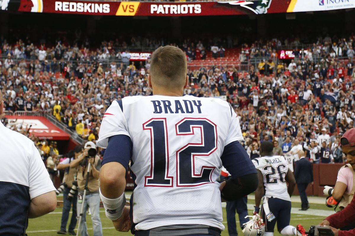 New England Patriots quarterback Tom Brady jogs off the field after the Patriots game against the Washington at FedExField.