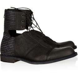"""<a href=""""http://www.theoutnet.com/product/173463"""">LD Tuttle The Lock cutout leather ankle boots</a>, $78.75 (were $525)"""
