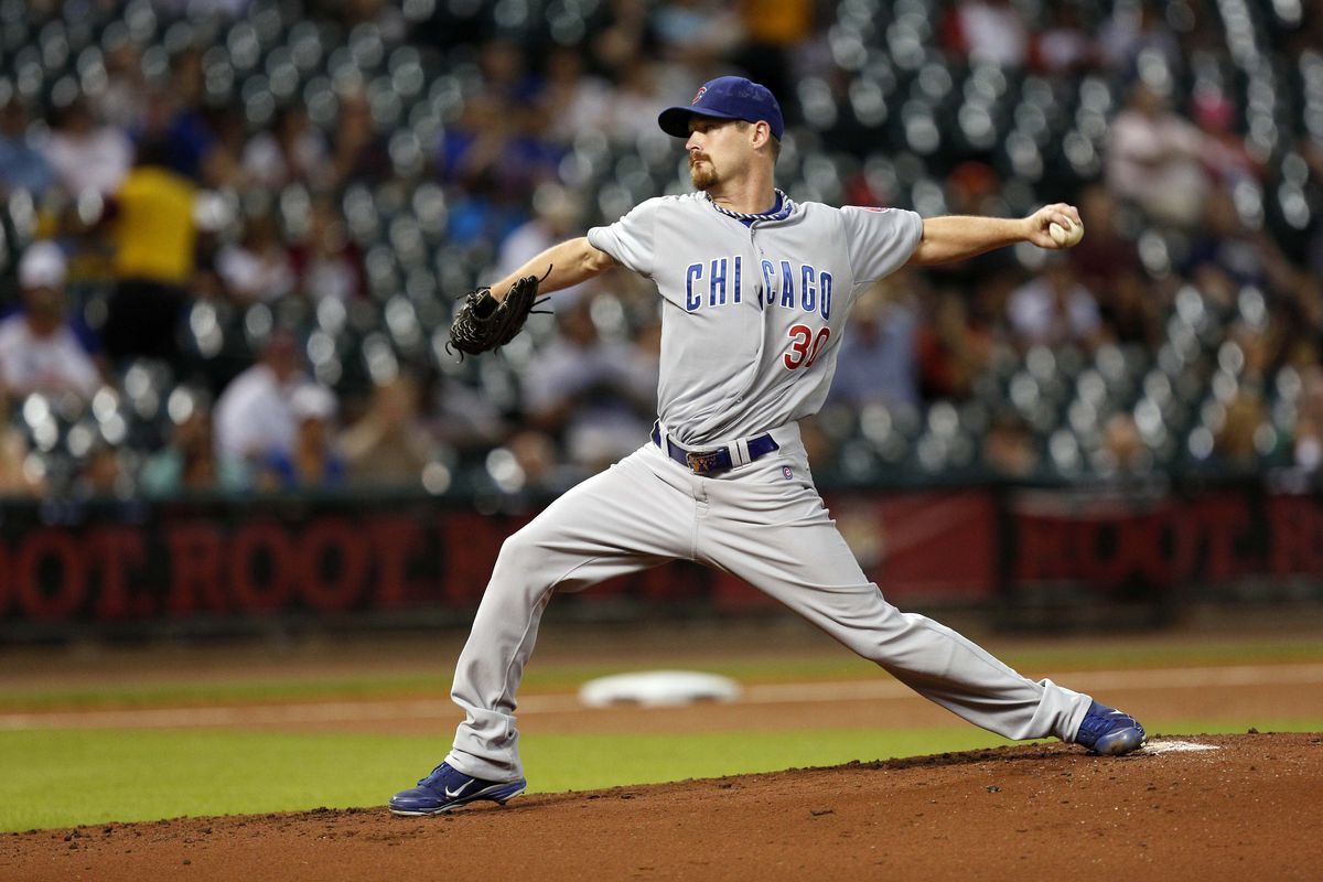 Sept 12, 2012; Houston, TX, USA; Chicago Cubs starting pitcher Travis Wood (30) pitches against the Houston Astros during the first inning at Minute Maid Park. Mandatory Credit: Thomas Campbell-US PRESSWIRE