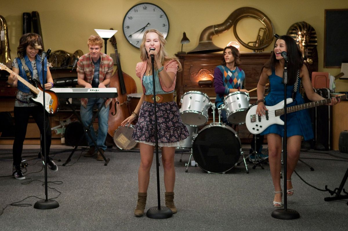 a group of five teens playing instruments and rocking out in safe, family-friendly teen rebellion