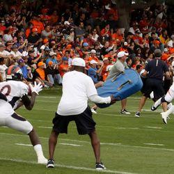 Broncos WR Gerell Robinson pulls in a Brock Osweiler pass during goal line drills