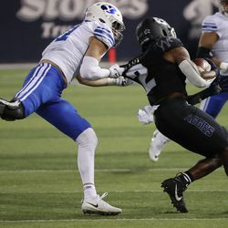 Brigham Young Cougars linebacker Max Tooley (31) tackles Utah State Aggies running back John Gentry (2) in Logan on Friday, Oct. 1, 2021.