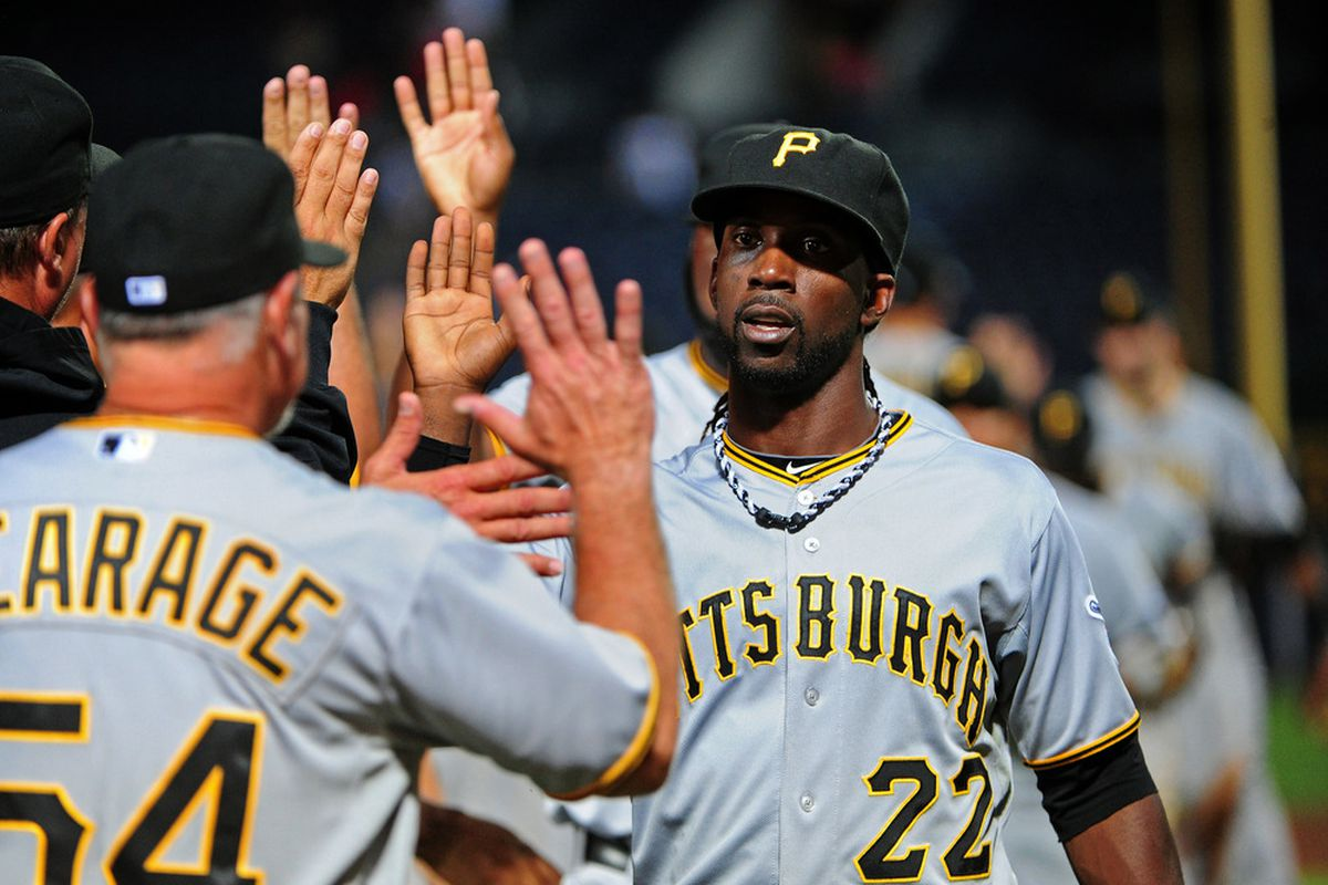 ATLANTA, GA - APRIL 30: Andrew McCutchen #22 of the Pittsburgh Pirates celebrates with teammates after the game against the Atlanta Braves at Turner Field on April 30, 2012 in Atlanta, Georgia. (Photo by Scott Cunningham/Getty Images)