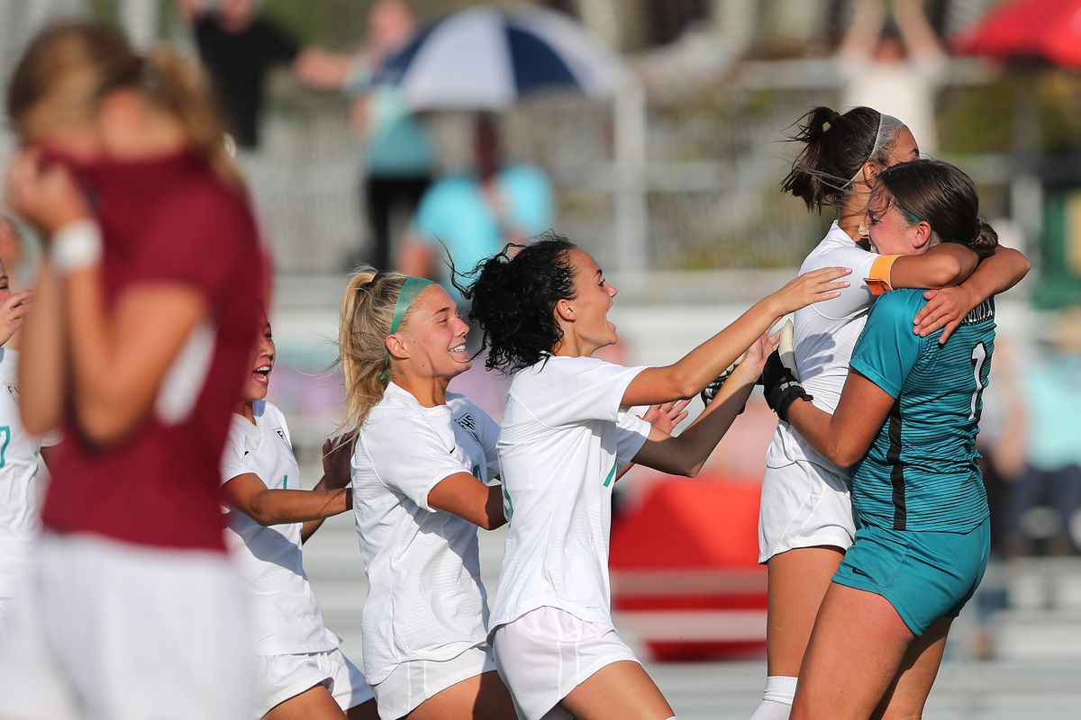 Farmington players swarm keeper Natalie Maire as they finish off Viewmont in Bountiful on Tuesday, Sept. 22, 2020. The teams battled to a 1-1 tie at the end of regulation play, but Farmington went on to advance with a 3-1 win in penalty kicks.